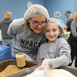 Sandra Torre and her daughter, Madeline, pack food for Feed My Starving Children.